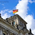 The German flag flies on top of the Reichstag